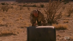 Walt roling a barell in desert